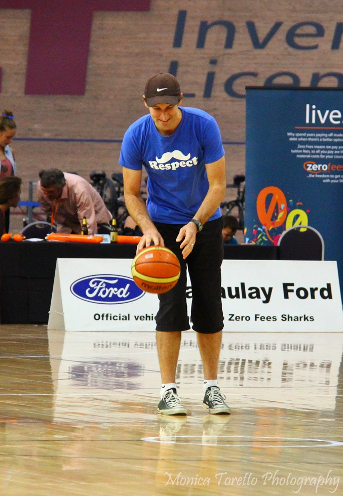 Lucky half time winner who gets a chance to shoot from half way & receive one thousand dollar prize.  Southland Sharks v Saints game, April 28th, 2013.  Stadium Southland.