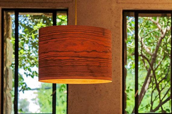 a minimalist drum shade that showcases the natural beauty of each individual unique wood material