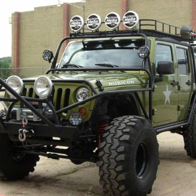 My First Love An Army Green Jeep With Raised Suspension