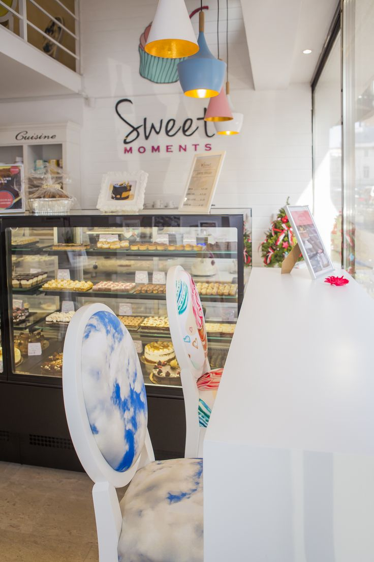 New design for a new sweets shop in Bucharest, with colored lamps and white wood by CorpConstruct.