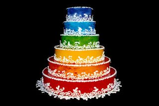 I like the white lace trim, but not much else about this one... Rainbow Wedding Cake