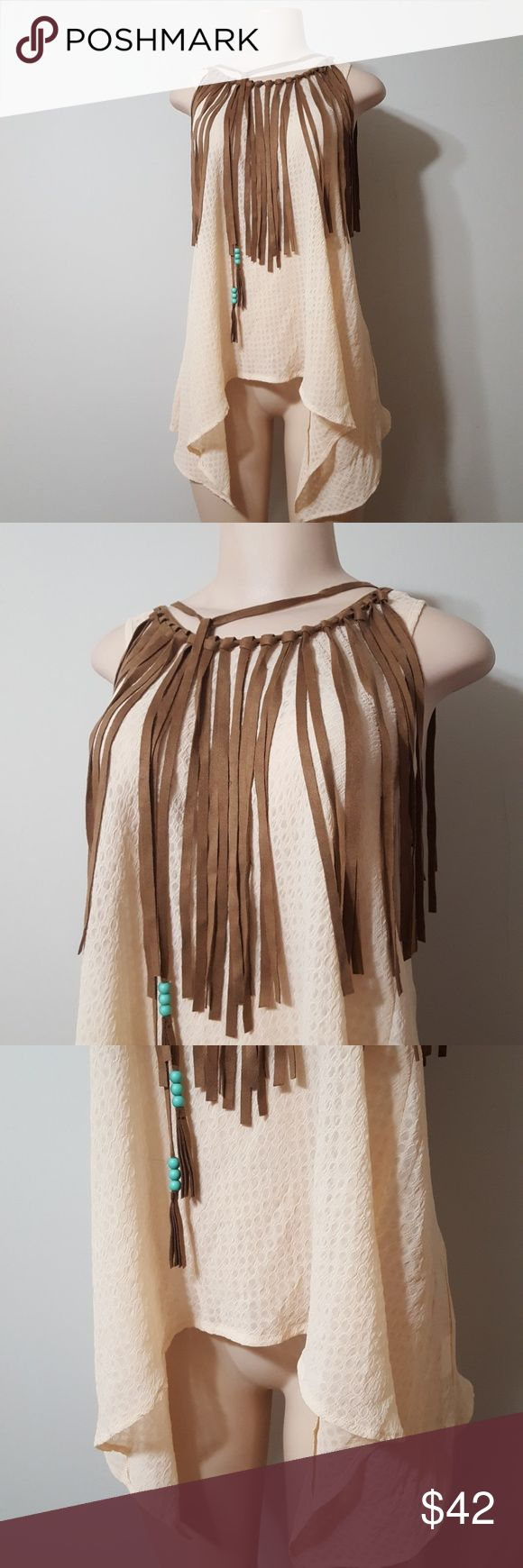 NWT! NEW! JUDITH MARCH FRINGE BLOUSE! NWT! NEW! JUDITH MARCH FRINGE BLOUSE! Love this look & design! High low cut top. Waffle imprint designed fabric. Semi sheer. Light peachy cream color. Long brown suede like fringe front & back. Two long ties with beads to wear in front for style or tie in back for style. This top is beautifully made!! NEW WITH TAGS. Boutique item & tags. Judith March Tops Blouses