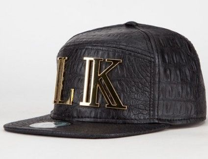 Tyga's LAST KINGS brand drops their latest cap using one of the most popular fabrics of the last year. The entire strapback is covered in faux black snakes