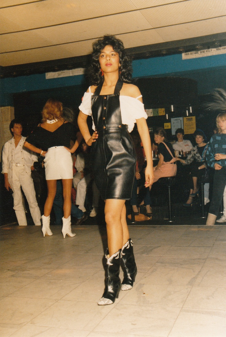 Gisela in leather pinafore