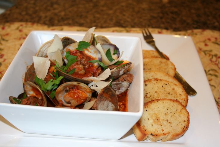 Spicy Clams and Sausage in marinara sauce w/crostini! Using Classico Tomato and Basil sauce AND Johnsonville Sausage