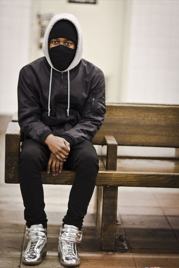 Hooded man sitting