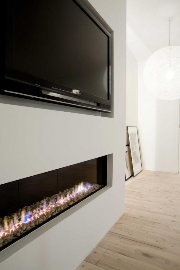 Dividing wall like this with TV on one side and art on the other. Modern. tv/fireplace