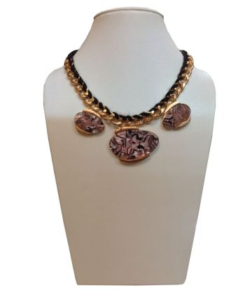 Black and golden necklace with shell design.