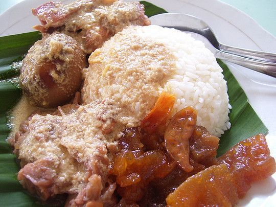 Gudeg, originated from central Java. Yogyakarta's is the best known gudeg. Chicken, eggs, green jackfruits are cooked in sweet coconut milk concoction. Hot-spicy beef skin crackers balanced the sweet taste.