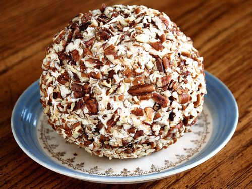 8 ounces, weight Cream Cheese  ¼ cups Sour Cream  1 cup Finely Shredded Cheddar Cheese  ¼ cups Shredded Parmesan Cheese  ¼ cups Finely Chopped Onion  ½ teaspoons Teaspoon Garlic Powder  1 pinch Cayenne Powder  1 teaspoon Lemon Juice  ¼ teaspoons Freshly Ground Black Pepper  ⅓ cups Dried Cranberries, Optional  ½ cups Toasted Pecans, Chopped Coarse (optional)