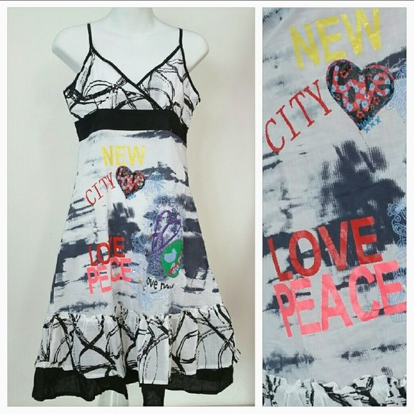 """'Life is Peaceful' Urban Chic dress NWT BRAND NEW with tags """"Life is Peaceful"""" Urban Chic dress. Dress features tons of details including colorful writing, beaded details and threaded details. Ruffle detail around bottom.   Adjustable straps Length is approx 38"""" but will vary depending on were you adjust your straps 100% cotton  *similar to anthro styles Dresses"""