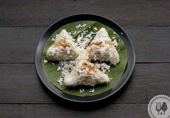 KUE LUPIS. Lupis made of glutinous 'sticky' rice, sprinkled with freshly grated coconut and topped with liquid palm sugar