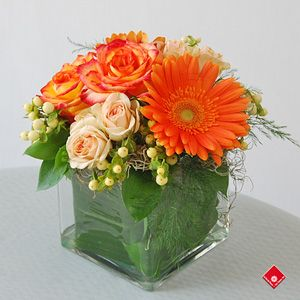 Gerberas and roses in a glass cube - The Flower Pot.