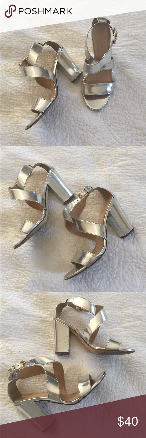 J.crew metallic silver sandal heels 7 This is a pair of J.Crew metallic silver high heel sandals size 7... worn a few times, with minor scuff marks (see photos) and some wear to soles... otherwise these fit like a dream and go with everything!!! Heel is about 4 inches, but you'd never know it!! J. Crew Shoes Sandals