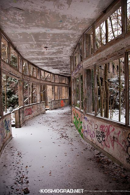 Inside the curved front of the abandoned Sanatorium in Paris.  A corridor in the Palace beside the Courtyard Garden