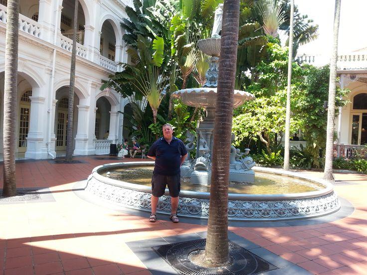 Rick in courtyard at Raffles