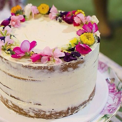 Semi-naked cake by Cake Ink with an edible flower crown...gorgeous!