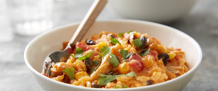 Destined to become a new family favorite, this slow-cooker dinner dishes out lots of love in the form of extra-cheesy rice, tender chicken, black beans and corn.