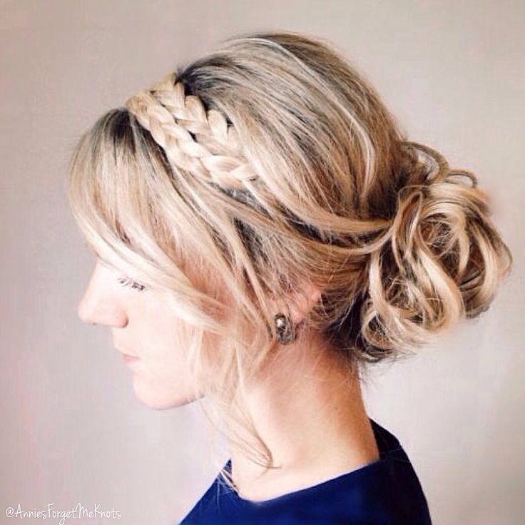 A curled updo with two braids as a headband.