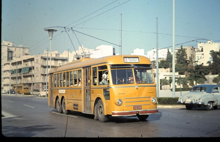 Athens trolley bus near the old Olympic stadium.  Roads full of American cars as the US Forces were still in Greece. Athens airport was a US Air Force base at that time which also handled civil flights.