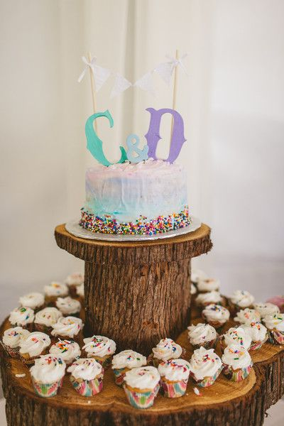From the ombre icing to the monogram cake topper and rainbow sprinkles on the cupcakes, we're so in love with this dessert display! {Ten2Ten Photography}