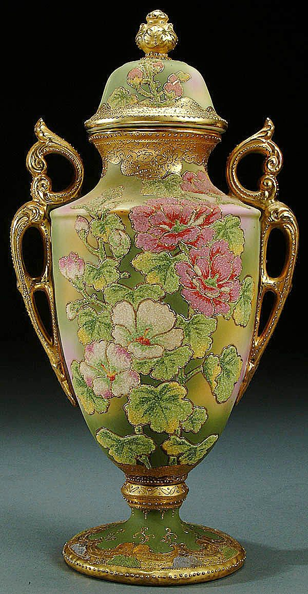 A NIPPON CORALENE DECORATED PORCELAIN TWO HANDLED LIDDED URN CIRCA 1909 WITH BEADED GLASS DECORATION OF WILD ROSES ON A MOTTLED PINK AND GREEN GROUND