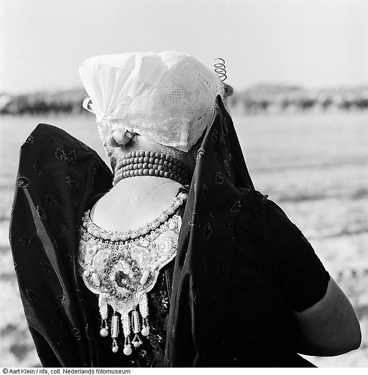 The costums of the people in the dutch province 'Zeeuws-Vlaanderen' (against the Belgian border) is beautifull and it's jewelry 'knot' quite famous. Photo 1962.