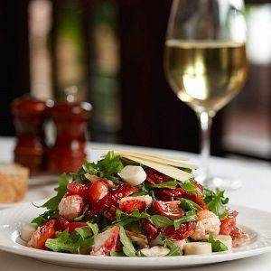 Lobster-Inspired Seasonal Dish at The Palm:  Baby Arugula, Hearts of Palm and Nova Scotia Lobster Salad with shitake mushrooms, fresh and sun-dried tomatoes, shaved parmesan and charred lemon vinaigrette #ThePalm #PalmRestaurant #Argula #Lobster #Mushroom #Tomato #Summer #Salad