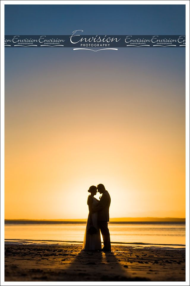 Jenny and Wade enjoying a moment post ceremony at Kingfisher Bay Resort's Sunset Beach. @kingfisherbay