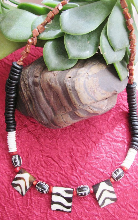 Attractive African style necklace, Zebra pattern on carved horn beads, ostrich shell, wood and gold stone beads
