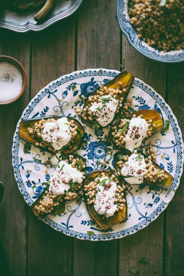 Moghrabieh stuffed Eggplants make a great side dish, especially wiht lamb! Spiced eggplants baked then filled with couscous and served with a dollop of greek yogurt gives this side dish a Middle Eastern flavor.