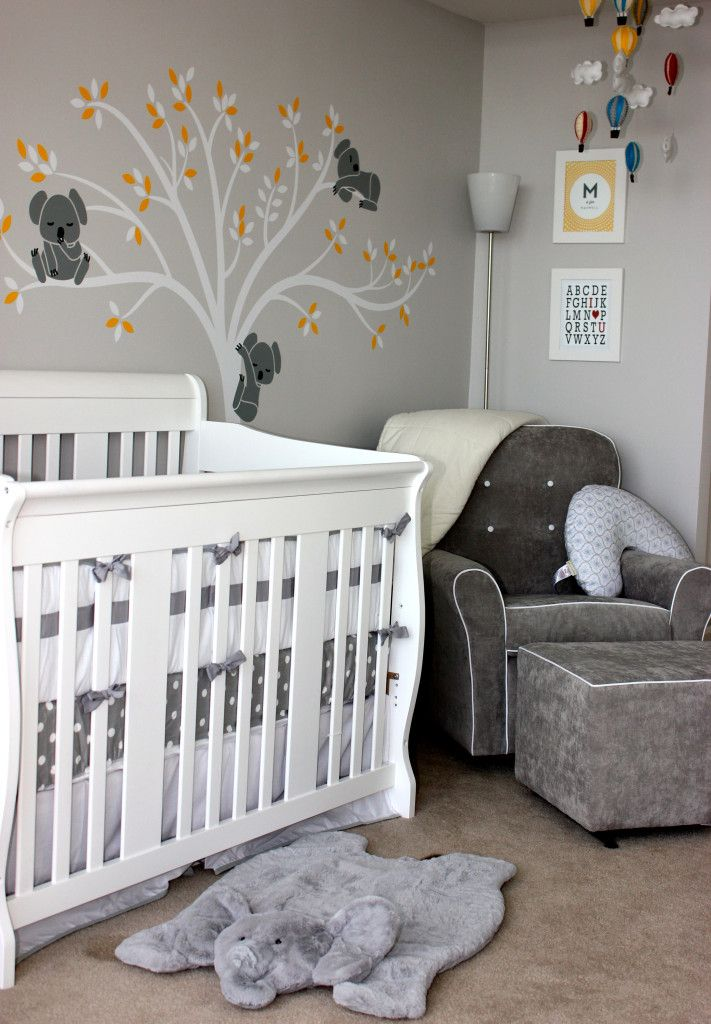 Cozy corner in this modern gray nursery