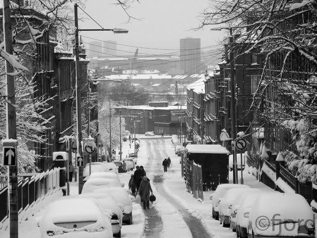 Walking uphill in the snow...Glasgow, Scotland.