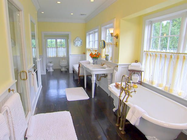 Cottage Chic - HGTV's Top 10 Designer Bathrooms on HGTV. Ti\his bath has it all. Space to lounge, soak, shower, and who would love the facilities in the water closet with bidet. Surely, you noticed all the natural light pouring through the windows. The charm of the vintage tub and sink are perfect for this space. This scores a 10!