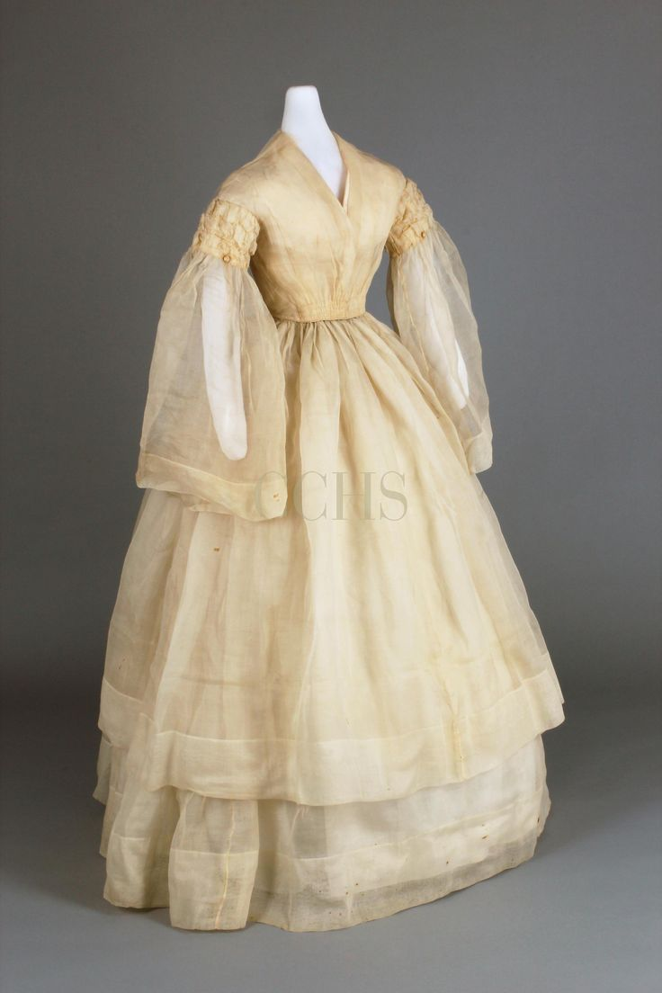 Wedding Dress, 1858-1863 | Chester County Historical Society WEDDING DRESS, 1858-1863  Ivory organza silk Gift of Eleanor Moore Webster  Eleanor H. Bechtel (1839-1926) married David Moore (1834-1869) of London Grove at Sunnyside, Kimberton by Friends' ceremony on October 20, 1859. This dress shows the restrained Quaker approach to fashionable dress of the time. Ten years later, David died of cholera. After her husband's death, Eleanor returned to Chester County and accepted the position of…