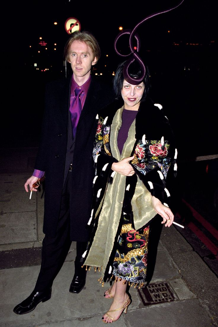 March 17, 1999 - Issy wears a Givenchy couture evening dress designed by then head of Givenchy creative Alexander McQueen. She is escorted by Philip Treacy attending the British Fashion Awards.