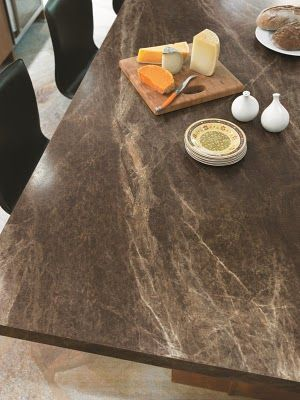 Formica laminate countertop in Slate Sequoia... really like the look, if the price is better than solid surface... why not.