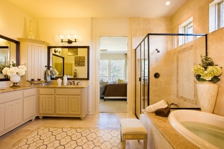 Beautiful stone inlay in the shower and floor. Dark faucets, mirror frames and shower enclosure provide contrast. The Perugia model from Sitterle Homes near San Antonio, TX #StartFreshBuyNew