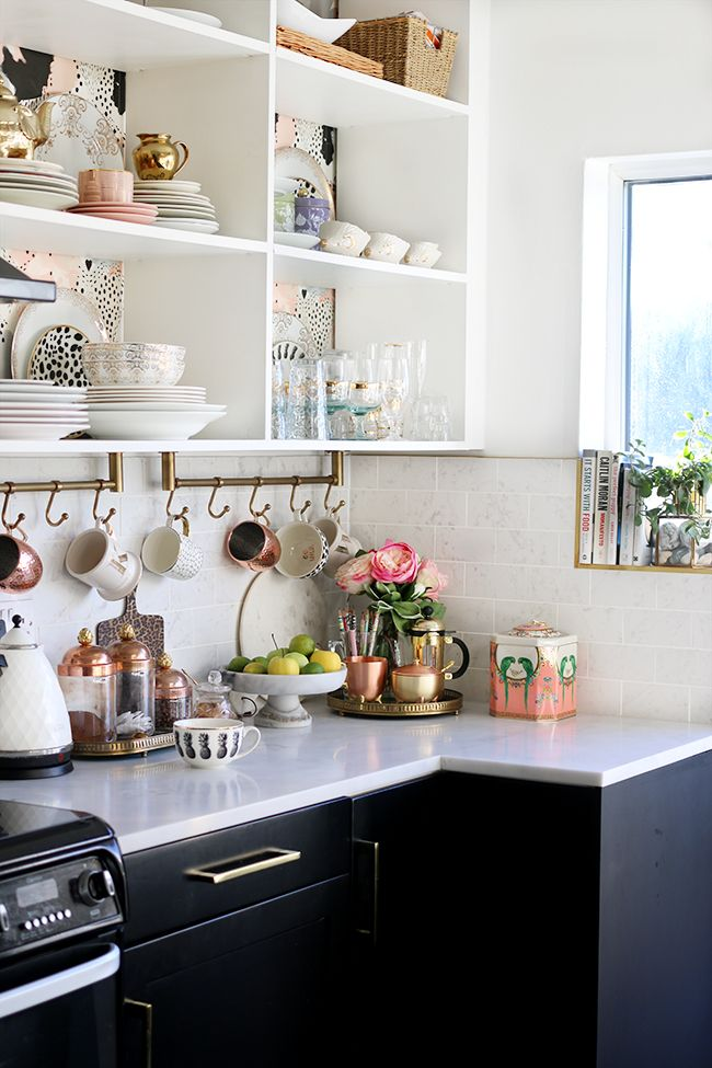 eclectic boho glam kitchen with open shelving and gold and copper accents