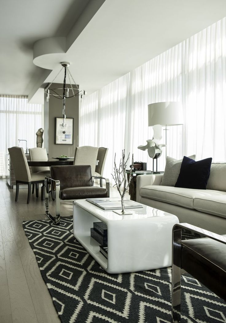 Stunning Penthouse Design With Exclusive Decoration: Sleek Contemporary Living  Room White Long Sofa Downtown Penthouse