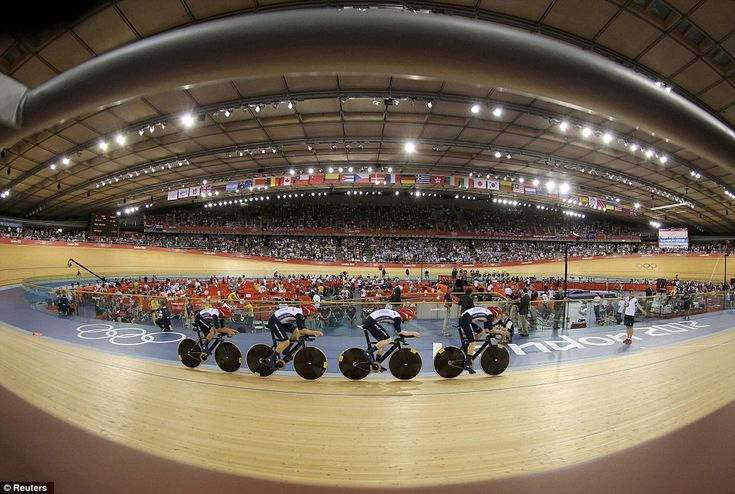 2012, August, London Olympics : Britain's Ed Clancy, Geraint Thomas, Steven Burke and Peter Kennaugh on their way to gold in the final of the men's team pursuit