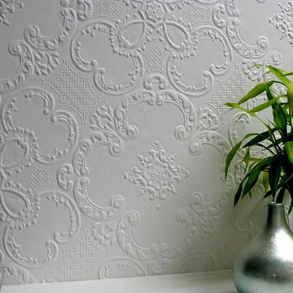 With an ornate ironwork design, this paintable wall paper brings luxe detail to walls with a diamond patterned backdrop swirled in elegant scroll details. Supag