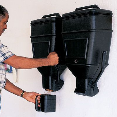 Jumbo Storage Dispenser -$42.95- No more bothersome stooping for heavy, broken or soiled bags. Our Jumbo Storage Dispenser is the clean, organized way to store and pour up to 40 lbs.—1 1/3 cu. ft. by volume—of charcoal, pet food, birdseed, detergent, etc. Simply pull the lever for a controlled release of contents into the 3 qt. cup (included).