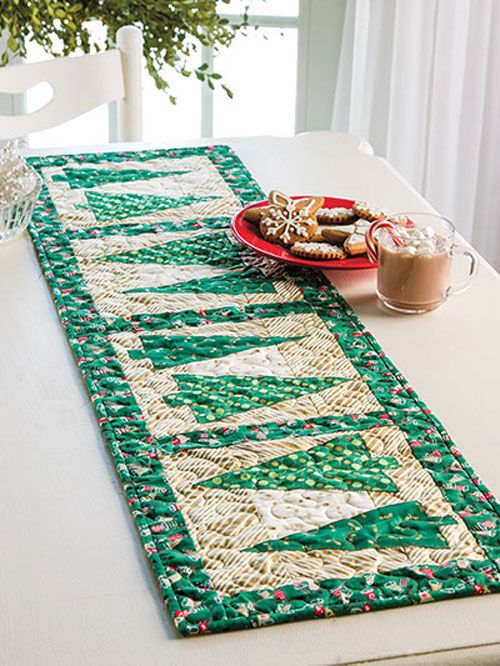 Show your Yuletide joy on your holiday table! Make this joyful yet simple table runner to decorate your table for all your holiday get-togethers. Featuring