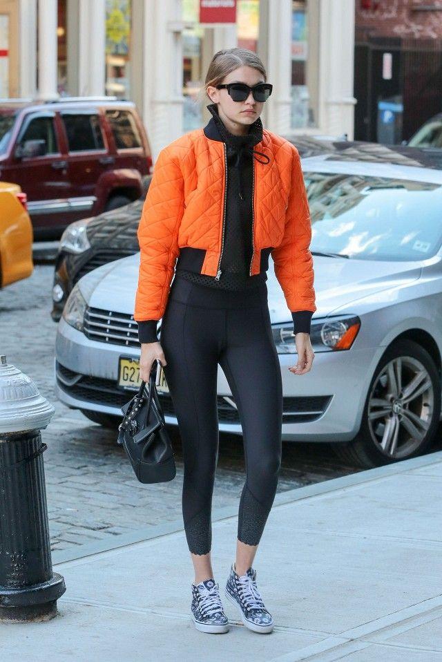 Gigi adds casual Vans to her leggings and bomber jacket look