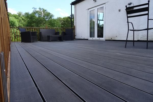 Cladco WPC Decking Boards in Charcoal Colour - were used to create this outside balcony area. www.wpc-decking.co.uk