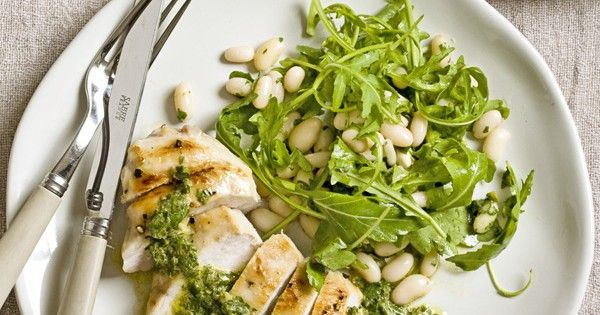 Salsa verde is a rich, fragrant sauce made with basil, parsley, capers, garlic and olive oil. It's often served with steak or lamb but this lighter update uses chicken breasts and cannellini beans for a quick Italian supper.