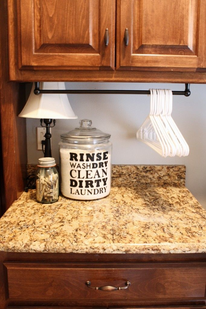 #LaundryOrganization #HangerHanger :: Laundry Room Organizing Ideas :: Towel rod to hang hangers