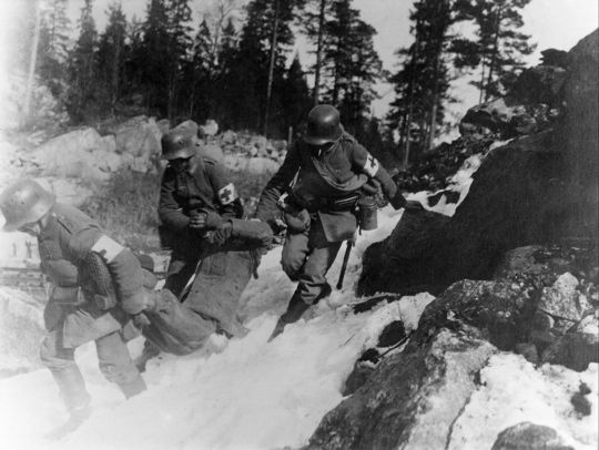 German Red Cross men bringing in wounded Finnish Red Guard 1918.