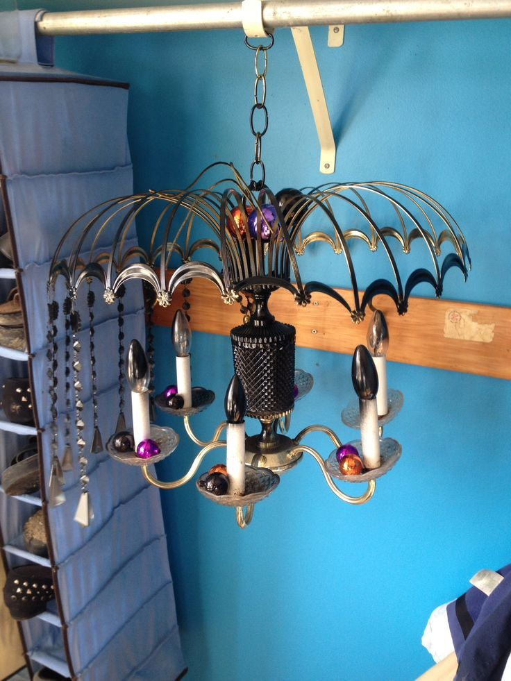 An old light fixture turned ghoulishly halloween with black spray paint and Signature Homestyles coloured balls